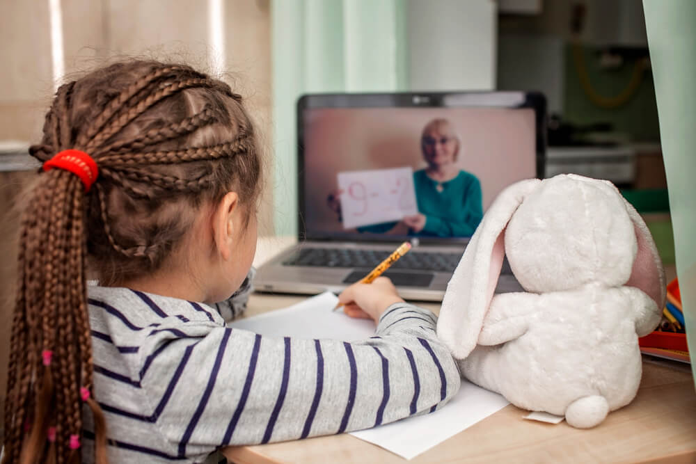 Schoolgirl Studying Math During Her Online Lesson at Home